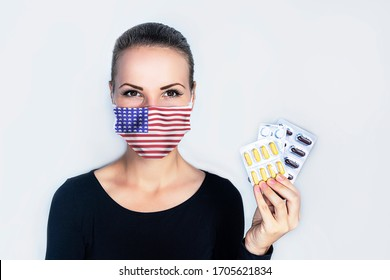 United States of America, USA. flag. Young, beautiful woman in a medical mask, on a white background. The female is holding a blister with troche and pills. from the virus coronavirus, epidemic