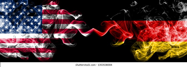 United States of America vs Germany, German smoky mystic flags placed side by side. Thick colored silky smoke flags of America and Germany, German.