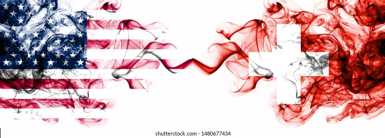 United States of America vs Switzerland, Swiss smoky mystic flags placed side by side. Thick colored silky abstract smokes banner of America and Switzerland, Swiss