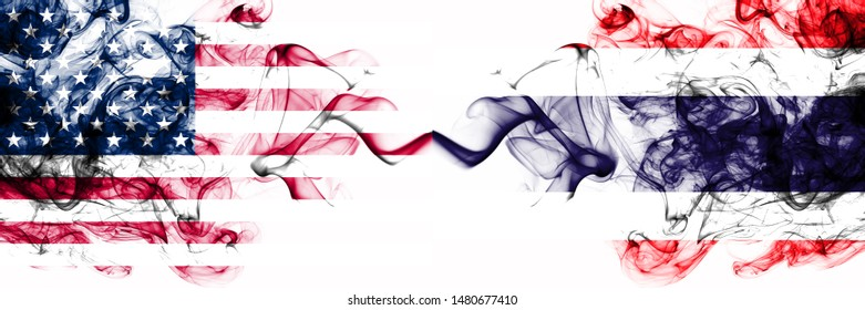 United States of America vs Thailand, Thai smoky mystic flags placed side by side. Thick colored silky abstract smokes banner of America and Thailand, Thai