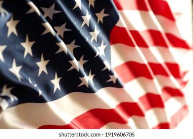 United States of America waving flag with many folds ,joe biden 2021