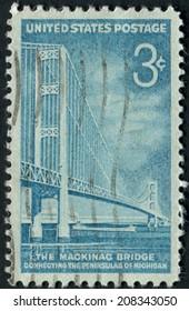 United States of America-Circa 1958: a stamp depicting the Mackinac Bridge in Michigan.