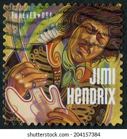 United States of America-Circa 2014: a stamp issued to honor legendary guitarist and musician Jimi Hendrix.