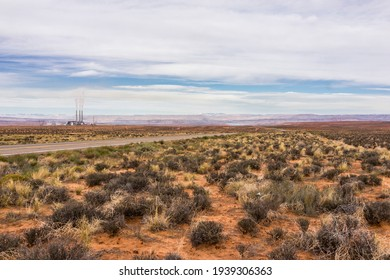 United States. Arizona. Desert with sagebrush along the U.S. Highway 89 between Page and Kaibito, through the Navajo Nation. On the left, the Navajo Generating Station.