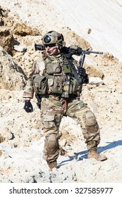 United States Army ranger in the mountains with machine gun