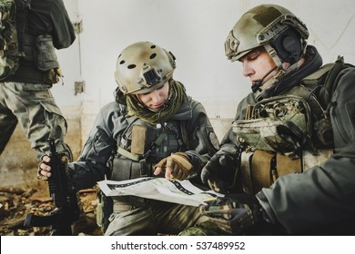 United States Army rangers during the military operation and  looking at the map