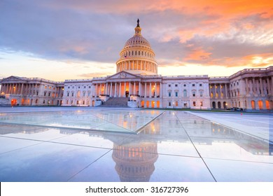 The United States Capitol building with the dome lit up at night USA.