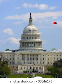 United States Capitol Building with a kite on the sky
