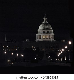 The United States Capitol building lit up at night, Washington D.C.  This landmark building is a symbol of liberty and freedom for many.