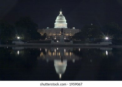 United States Capitol Building at Night with Reflection in Washington DC
