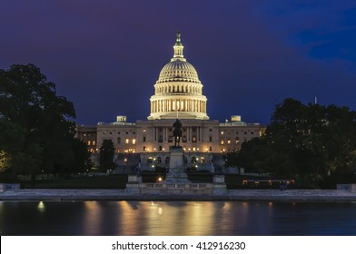 United States Capitol Building and Capitol Reflecting Pool at evening after sunset, Washington D.C., District of Columbia, USA