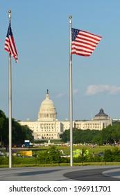 United States Capitol building with US flags around Washington Monument - Washington DC