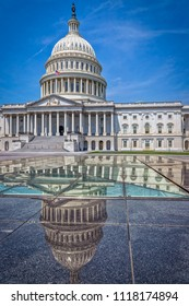The United States capitol building in Washington DC on a summer day.