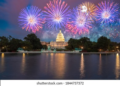 The United States Capitol building in Washington DC at night with fireworks - Shutterstock ID 1844737372