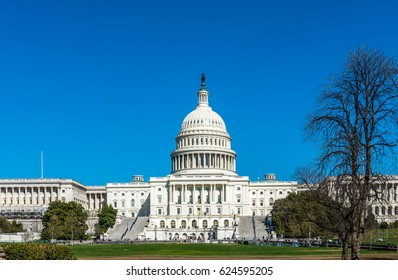 The United States Capitol Building in Washington DC stands high on its so named hill.
