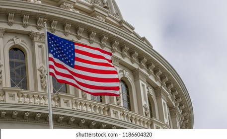 United States Capitol building with waving American flag in Washington DC
