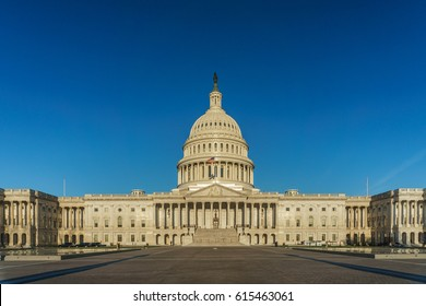 United States Capitol with a deep blue, cloudless sky