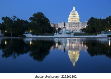 United States Capitol, Government in Washington, D.C., United States of America. Illuminated at night with reflection showing in reflecting pool.