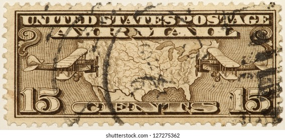 UNITED STATES - CIRCA 1928: Fifteen Cent Airmail stamp printed in United states (USA), shows map with two bi-planes, circa 1928