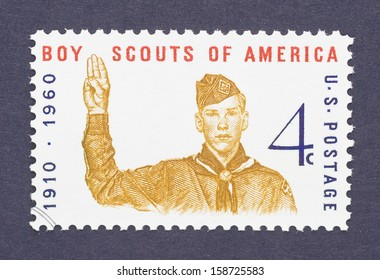 UNITED STATES - CIRCA 1960: a postage stamp printed in USA showing an image of boy scout giving the scout sign and commemorative of the 50th anniversary of Boy Scouts America, circa 1960.