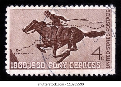 UNITED STATES - CIRCA 1960: A  stamp printed in the United States shows Pony Express Rider, honoring 100 yrs of the Pony Express the first American mail delivery system , circa 1960