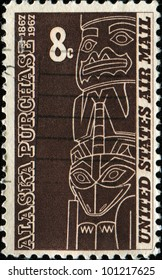 UNITED STATES - CIRCA 1967: A stamp printed in the United States shows the Tlingit totem is from the Alaska state Museum, Juneau, Alaska Purchase Issue, circa 1967