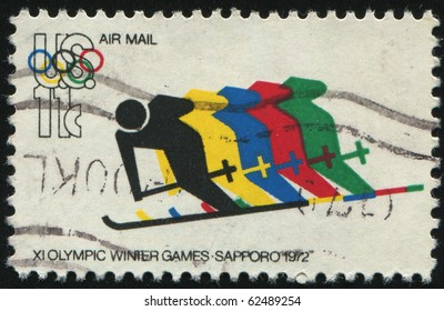 UNITED STATES - CIRCA 1972: stamp printed by United states, shows Skiing and Olympic Rings, circa 1972.