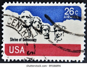 UNITED STATES - CIRCA 1974:A stamp printed in USA shows image of the Mount Rushmore National Memorial is a sculpture carved into the granite face of Mount Rushmore near Keystone, circa 1974.