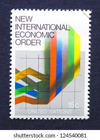 UNITED STATES � CIRCA 1980: a postage stamp printed in USA showing an image of the new international economic order with six colorful vertical lines, circa 1980.