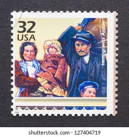 UNITED STATES - CIRCA 1998: a postage stamp printed in USA showing an image of an immigrant family, circa 1998.