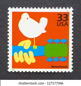 UNITED STATES - CIRCA 1999: A postage stamp printed in USA showing an image of the Woodstock festival poster, circa 1999.
