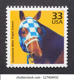 UNITED STATES - CIRCA 1999: a postage stamp printed in USA showing an image of Secretariat the first racehorse to win the US Triple Crown, circa 1999.