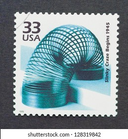 UNITED STATES � CIRCA 1999: a postage stamp printed in USA showing an image of the slinky toy created by Richard James, circa 1999.