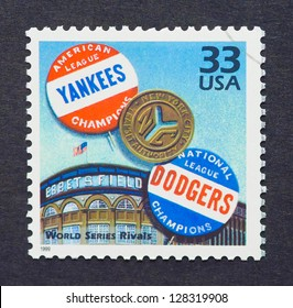 UNITED STATES � CIRCA 1999: a postage stamp printed in USA showing an image of the New York Yankees and Brooklyn Dodgers buttons, circa 1999.