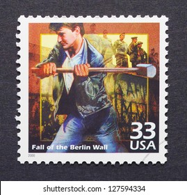 UNITED STATES -Â?Â? CIRCA 2000: a postage stamp printed in USA showing an image of the fall of Berlin Wall, circa 2000.