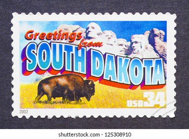UNITED STATES � CIRCA 2002: a postage stamp printed in USA showing an image of the South Dakota state, circa 2002.