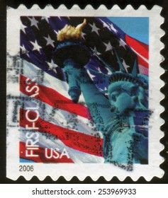 UNITED STATES - CIRCA 2006: postage stamp printed in USA showing  Statue of Liberty, sculpture on Liberty Island in New York Harbor in New York City on the background of the American flag, circa 2006.
