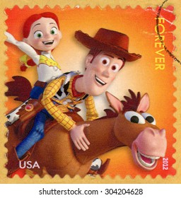 UNITED STATES - CIRCA 2012: forever stamp printed in USA (US) shows 3 characters from movie Toy Story 2; Sheriff Woody and cowgirl Jessie riding on horse Bullseye; mail a smile; Scott 4680; circa 2012