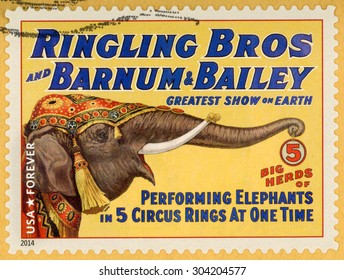 UNITED STATES - CIRCA 2014: forever stamp printed in USA (US) shows big herds of performing elephants at 5 circus rings at one time; circus vintage posters; Ringling Bros, Barnum & Bailey; circa 2014
