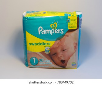 United States, Circa 2018: Pampers newborn infant size diapers packaging product photo against white background. Illustrative Editorial