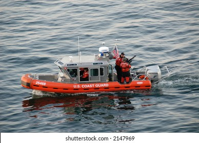 United States Coast Guard patrol boat with armed soldiers on new england coast