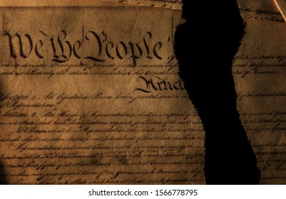 The United States Constitution showing We The People torn in half