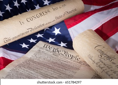 United States declaration of independence, constitution and bill of rights on an american flag