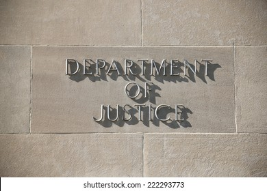 United States Department of Justice building sign in Washington D.C.