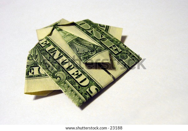 United States dollar bills folded origami style into a shirt and tie