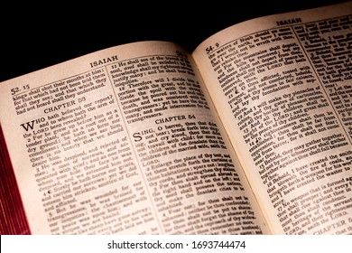 United States - February 27, 2020: Antique Holy Bible opened, Old Testament. The Bible is the source and basis of doctrines of the Christian religion. Isaiah 53.