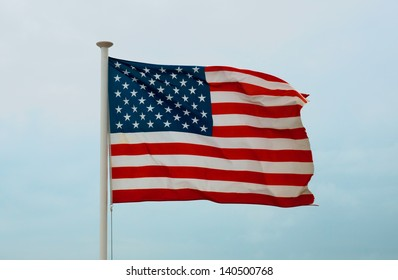 United States Flag against a sky background