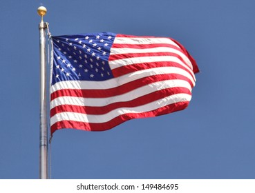 united states flag with blue sky background