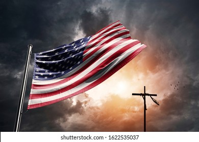 United States flag with christian cross on a dramatic sunset.
