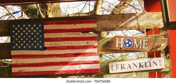 United states flag and Franklin Tennessee sign